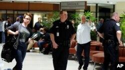 Des policiers patrouillent dans l'aéroport de las Nouvelle-Orléans, 20 mars 2015