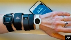 Fitness Trackers are wearable devices made to help you lose weight. But do they work? (AP Photo/Bebeto Matthews)
