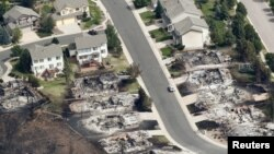 Some of the hundreds of totally destroyed homes are seen in the aftermath of the Waldo Canyon fire in Colorado Springs, Colorado June 28, 2012.