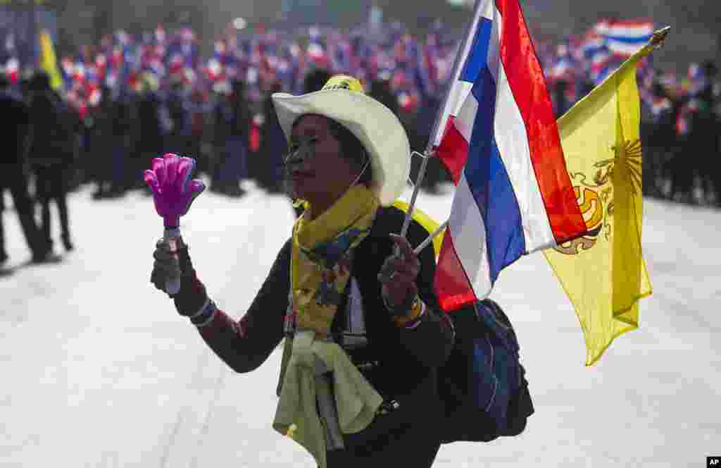 An anti-government protester leads the group during a march in Bangkok, Jan. 17, 2014.