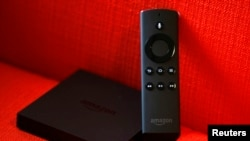 An Amazon Fire TV set is seen on a couch after a news conference in New York, April 2, 2014. Amazon.com Inc unveiled a $99 video streaming device called Fire TV that the e-commerce company promised would be more powerful and easier to use than rival services by Apple Inc, Google Inc and Roku. Amazon is a latecomer to the set-top TV market that is dominated by the Apple TV. Amazon customers have a large appetite for film and TV, but many already own similar devices, analysts said.