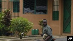 A Republican Forces soldier runs as security forces loyal to President Alassane Ouattara investigate reports of looting, in the Cocody neighborhood of Abidjan, Ivory Coast, April 13, 2011