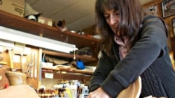 Carving patterns into leather is a skill that saddle maker Nancy Martiny first learned as a teenager while watching her father tool leather