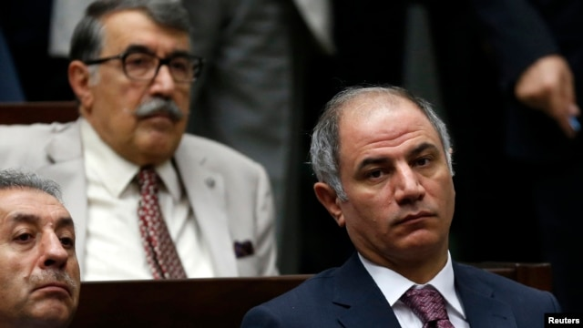 Turkey's Interior Minister Efkan Ala (R) attends a meeting at the Turkish parliament in Ankara, July 22, 2014.
