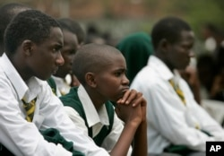 Students at Jamhuri High school in Nairobi listen as Kenyan President Mwai Kibaki addresses them, Monday, Feb. 11, 2008 as he officially launched free secondary education for all Kenyan's. (AP Photo/Karel Prinsloo)