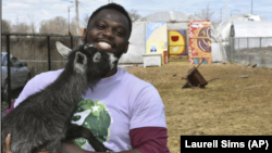 This April 10, 2020 photo shows Marshall Mitchell, Urban Farm Assistant at the Urban Growers Collective farm in Chicago. The nonprofit teaches young kids and others to grow vegetables at eight urban farms around the city. (Laurell Sims via AP)