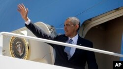 President Barack Obama waves as he boards Air Force One before his departure from Andrews Air Force Base, Md., May 2, 2013.
