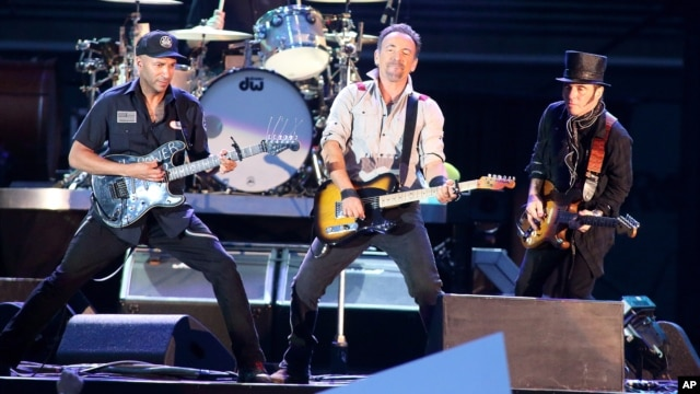 "Bruce Springsteen and The E Street Band perform in concert during their ""High Hopes Tour"" at Hershey Stadium on May 14, 2014, in Hershey, Pa. (Photo by Owen Sweeney/Invision/AP)"
