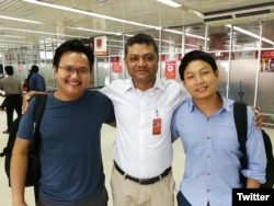 Myanmar photojournalists Minzayar Oo and Hkun Lat, who were arrested in Bangladesh, are seen with their lawyer in a photo posted on Twitter, Oct. 17, 2017.