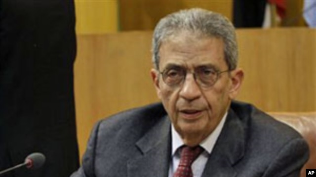 Arab League chief Amr Moussa attends the Arab League emergency meeting in Cairo, Egypt, March 12, 2011