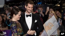 Actors Andrew Garfield, right, and Claire Foy pose for photographers upon arrival at the premiere of the film 'Breathe,' showing as part of the London Film Festival opening gala, in London, Oct. 4, 2017.