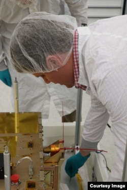 Cal Poly CubeSat engineer Ryan Nugent works with the Prox-1 spacecraft following LightSail 2 final integration on 7 May 2019 at the Air Force Research Laboratory in Albuquerque, New Mexico. Prox-1 contains LightSail 2. (Photo: Air Force Research Laborator