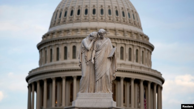 The statue of Grief and History stands in front of the Capitol Dome in Washington October 15, 2013.