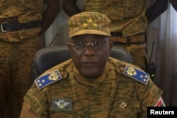 Burkina Faso's military chief General Honore Traore speaks at a news conference announcing his takeover of power, at army headquarters in Ouagadougou, Oct. 31, 2014.