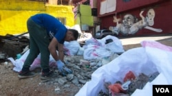 Ayad Nasser has also paid for the neighbourhood to be cleaned up. (J. Owens for VOA)