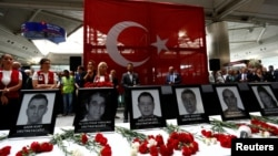 Ceremony for those killed in attack at the departure terminal of Ataturk airport in Istanbul, Turkey. (June 30, 2016.)
