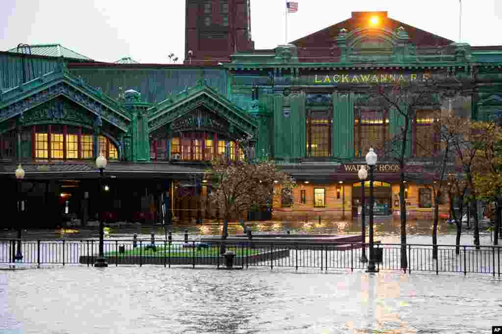 The Hudson River swells and rises over its banks flooding the Lackawanna train station as Hurricane Sandy approaches Hoboken, New Jersey.