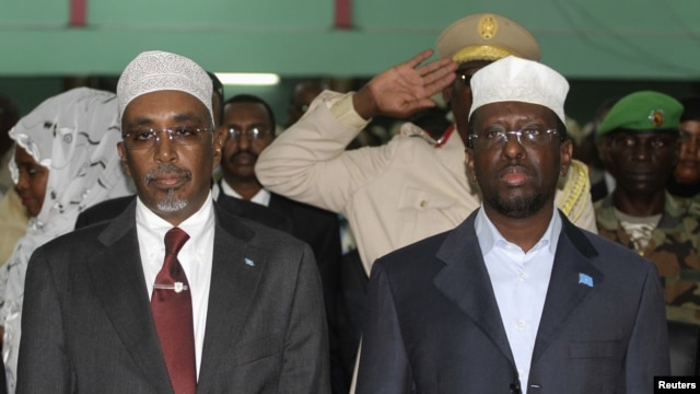 Somalia's President Sheikh Sharif Ahmed (R) and Speaker of the Parliament Sharif Hassan Sheikh Adan attend the National Constituent Assembly meeting in the capital Mogadishu, July 25, 2012.