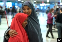 FILE - Halima Mohamed embraces her daughter in New York, March 8, 2017. Mohamed and her husband, who are from Somalia but live in the U.S., originally expected their daughters to arrive earlier this year, but the process was delayed due to the initial White House travel ban.