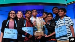 The eight co-champions of the 2019 Scripps National Spelling Bee, from left, Shruthika Padhy, 13, of Cherry Hill, N.J., Erin Howard, 14, of Huntsville, Ala., Rishik Gandhasri, 13, of San Jose, Calif., Christopher Serrao, 13, of Whitehouse Station, N.J., S