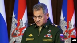 FILE - In this Thursday, Dec. 22, 2016 file photo, Russian Defence Minister Sergei Shougu speaks during a meeting with senior military officials in Moscow, Russia. Sergei Shoigu told lawmakers Wednesday, Feb. 22, 2017, that the sweeping military modernization program will continue at a high pace this year. Amid tensions with the West, the Kremlin has continued to spend big on new weapons despite Russia's economic downturn.