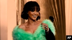 "FILE - Rihanna arrives on stage to perform ""Love On The Brain"" at the Billboard Music Awards in Las Vegas."