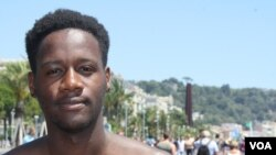 "In Nice, France, American-Congolese university student from Boston, Bahati Nkera, 20, says after terrorist attacks, ""you see many political groups push through their agenda."" July 16, 2016. (H.Murdock/VOA)"