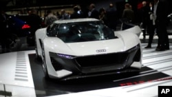 The Audi PB 18 e-tron is on display at the Auto show in Paris, France, Tuesday, Oct. 2, 2018, 2018. (AP Photo/Thibault Camus)