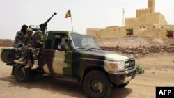 FILE - This file picture dated July 29, 2013, shows Malian soldiers patrolling in Kidal, northern Mali.