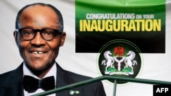 A banner with a portrait of Nigerian President-elect Mohammadu Buhari is displayed at the Eagle Square ahead of Fridays handover ceremony in Abuja, May 28, 2015.