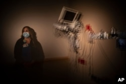n this photo created with an in-camera multiple exposure, registered nurse Christina Anderson, part of a group of nurses who had been treating coronavirus patients in an intensive care unit, stands for a photo in the empty COVID-19 ICU at Providence.