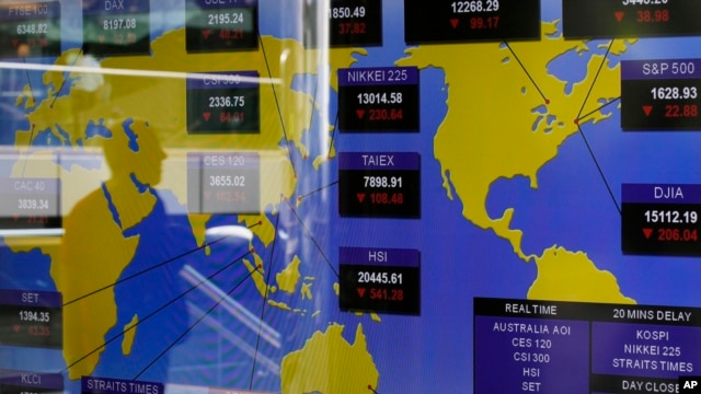 A TV screen shows the Asian stocks index at the Hong Kong Stock Exchange in Hong Kong, June 20, 2013.
