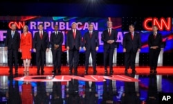 FILE - Republican presidential candidates, from left, John Kasich, Carly Fiorina, Marco Rubio, Ben Carson, Donald Trump, Ted Cruz, Jeb Bush, Chris Christie, and Rand Paul take the stage during the CNN Republican presidential debate at the Venetian Hotel & Casino