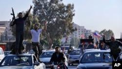 شماری از قوای حامی رئیس جمهور سوریه در دمشق شعار های ضد امریکا، برتیانیا و فرانسه سر دادند