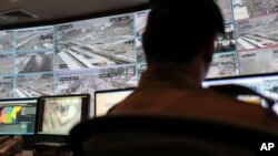 FILE - A security officer monitors Muslim pilgrims attending the annual hajj pilgrimage on CCTV screens at a security command center in Mina, Saudi Arabia, a day after a stampede killed more than 700 people, Sept. 25 2015.