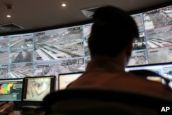 FILE - A security officer monitors Muslim pilgrims attending the annual hajj pilgrimage on CCTV screens at a security command center in Mina, Saudi Arabia, a day after a stampede killed more than 700 people, Sept. 25, 2015.