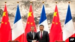 法国总统马克龙2018年1月9日会见中国国家主席习近平(美联社)