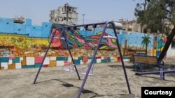 Swings are seen at a park in central Raqqa that was recently restored, nearly two years after IS was removed from the city, in Raqqa, Syria, June 25, 2019. (Courtesy photo)