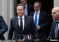 FILE - British Prime Minister David Cameron said Sept. 27, 2015, Syrian President Bashar al-Assad could stay on as part of a transitional government but shouldn't be part of a long-term solution, Sept. 7, 2015.