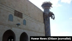 A mosque in the Kurdish town of Tall Maruf, Syria, destroyed in Syria.