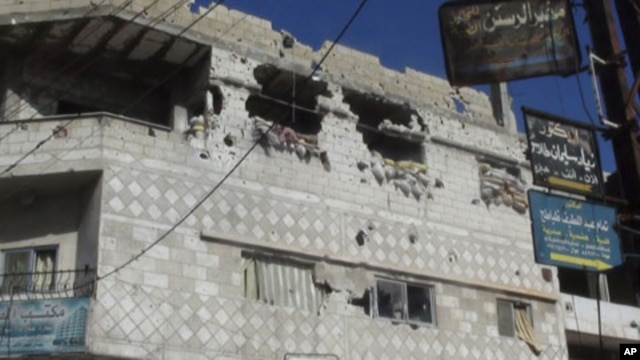 A view of houses that residents said were damaged during a military crackdown on protesters against Syrian President Bashar al-Assad, is seen in Rasten near Homs, February 3, 2012.