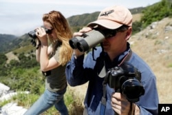 Ventana Wildlife Society executive director Kelly Sorenson, right, and wildlife biologist Amy List monitor California condors in the Ventana Wilderness east of Big Sur, California, June 21, 2017.