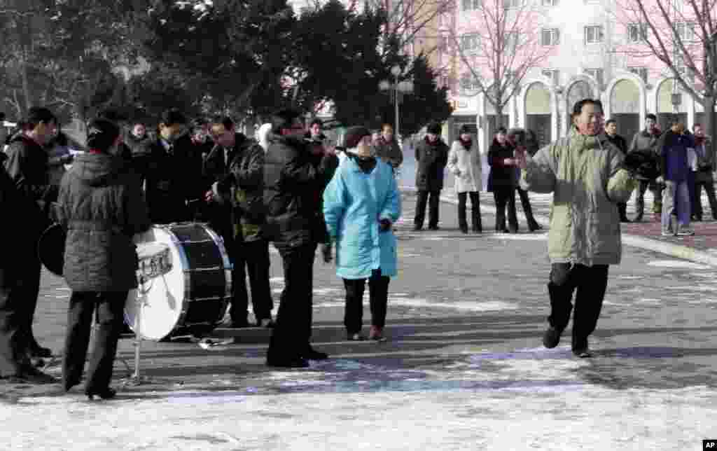 A North Korean dances to music in front of the Pyongyang Grand Theater, December 12, 2012.