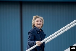 Democratic presidential candidate Hillary Clinton boards her campaign plane in White Plains, N.Y., Oct. 4, 2016.