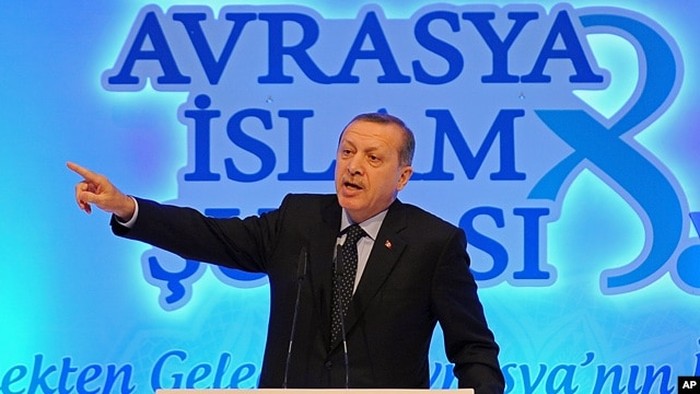 Turkish Prime Minister Recep Tayyip Erdogan addresses a meeting of Muslim religious leaders from Europe and Asia, in Istanbul, Turkey, Nov. 19. 2012.