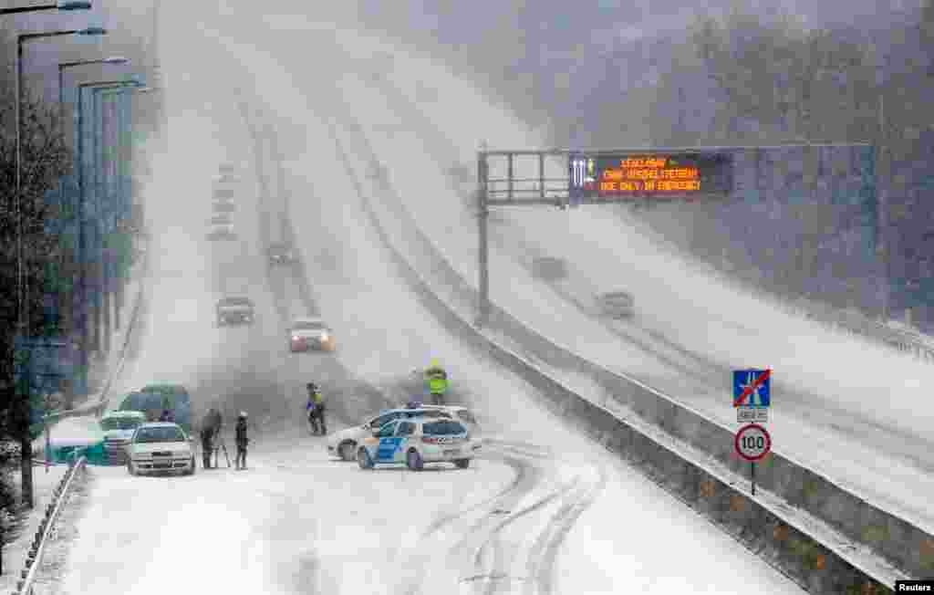 Police block the traffic at M1-M7 highway outside of Budapest, as heavy snow hits Hungary.