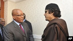 South Africa's President Jacob Zuma (C) greets Libyan leader Moammar Gadhafi (R) before their meeting in Tripoli in this handout picture taken May 30, 2011