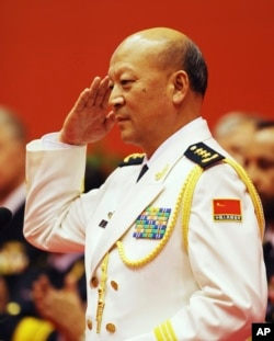 FILE - China Navy Commander Adm. Wu Shengli salutes after he made a speech duirng an opening ceremony to mark the 60th anniversary of the founding of the Chinese People's Liberation Army (PLA) Navy at Qingdao Port.