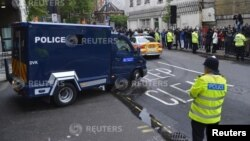 A police van carrying Michael Adebowale leaves Westminster Magistrates Court in London, May 30, 2013.