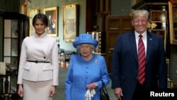 Britain's Queen Elizabeth stands with U.S. President Donald Trump and his wife, Melania